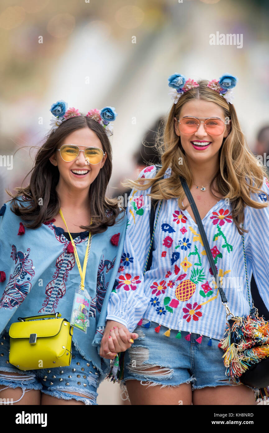 Girls with matching outfits at the Glastonbury Festival 2017 - Stock Image