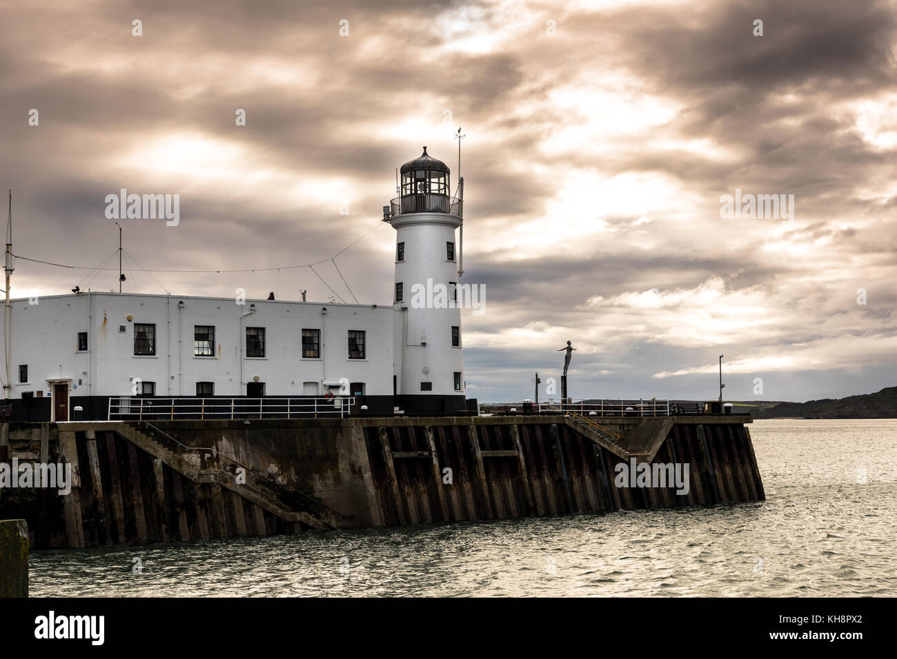Scarborough Lighthouse Under Moody Sky - Stock Image