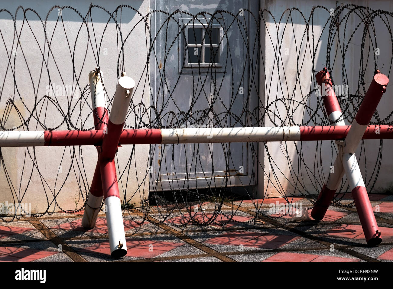 barb wire on entrance to the restricted area - Stock Image