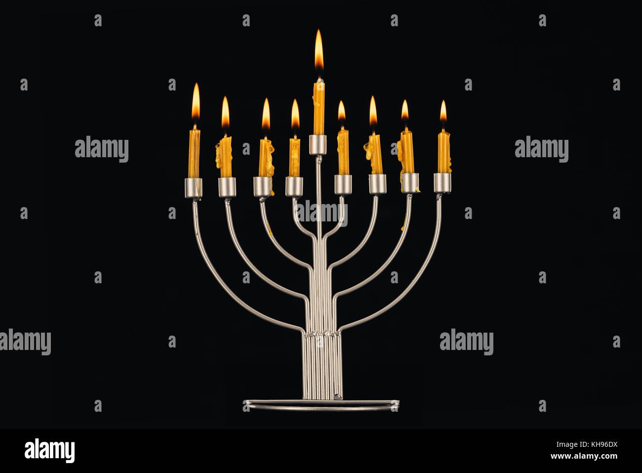 hanukkah celebration with menorah and candles - Stock Image