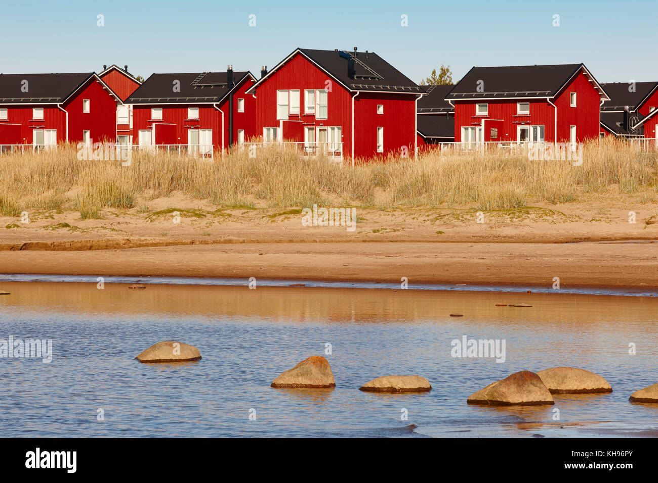 Red wooden houses near Marjaniemi beach, Hailuoto island. Finland. Travel - Stock Image