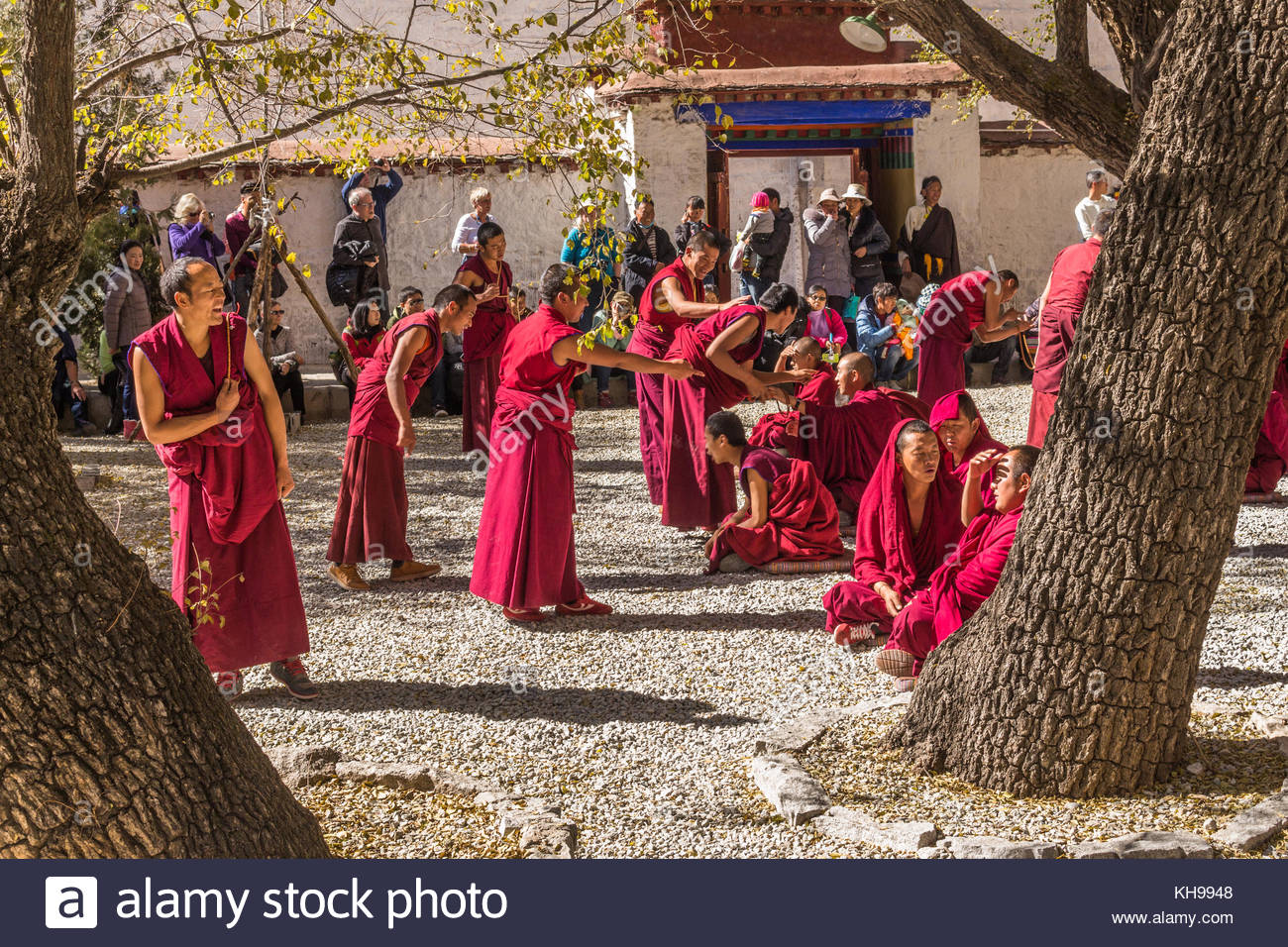 Debating monks at the Sera Monastery in Tibet - Stock Image