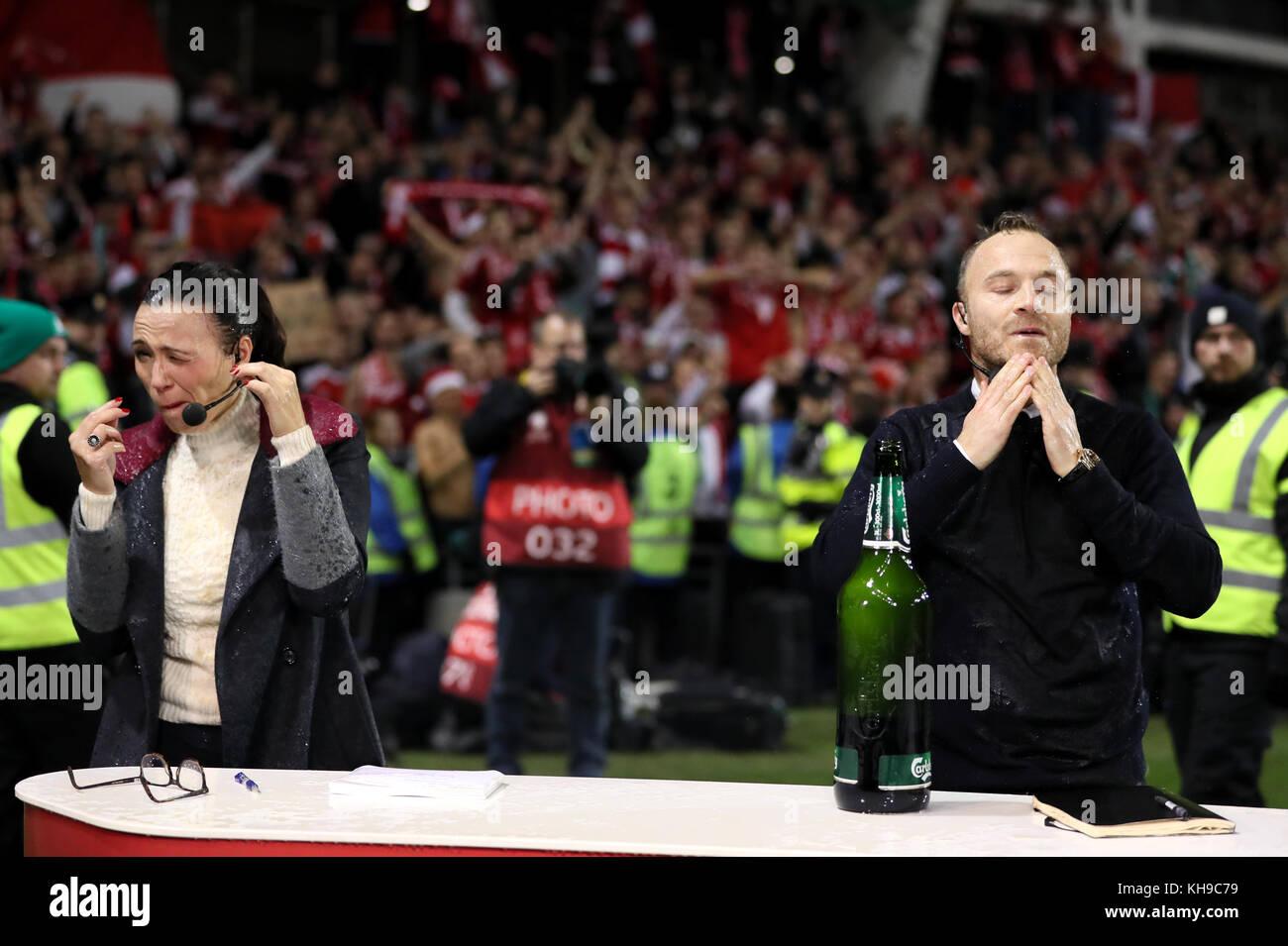 Danish TV presenters Mette Cornelius (left) and former footballer Lars Jacobsen react after members of the Danish - Stock Image