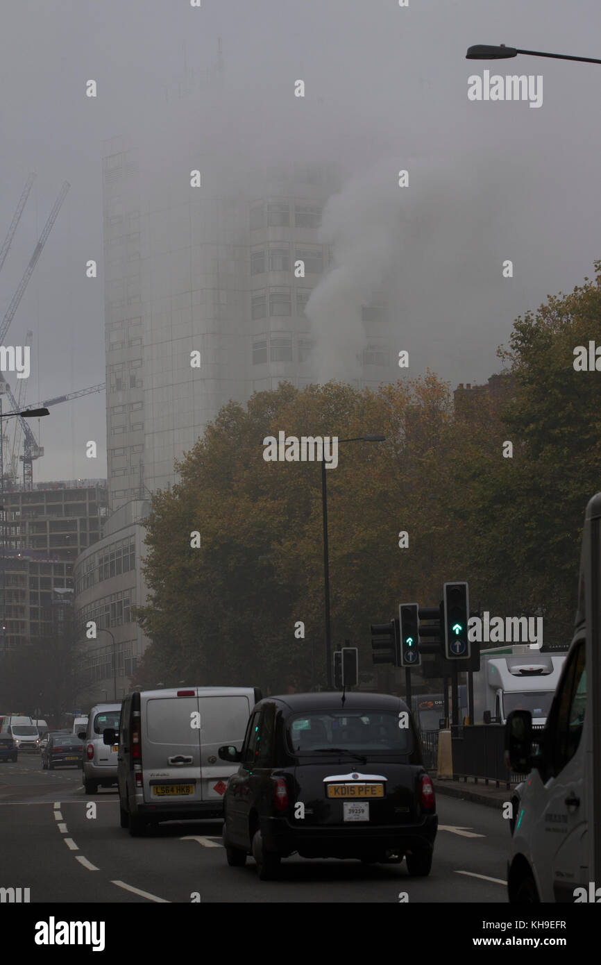 Smoke rises from a emergency fire in a hotel room closely to Marylebone Road, central London, UK - Stock Image