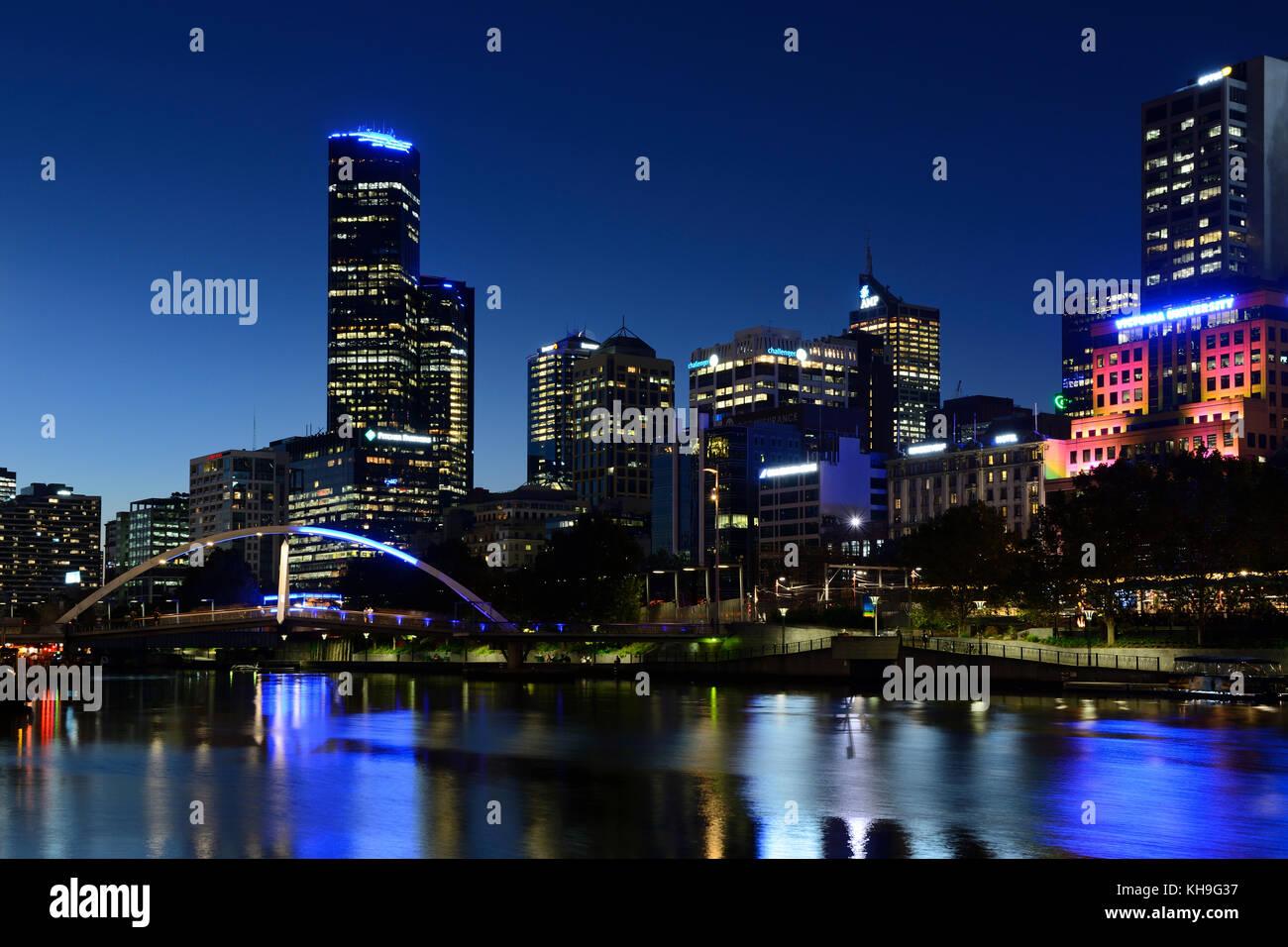 Northbank city skyline and Evan Walker Bridge on Yarra River by night - Melbourne, Victoria, Australia - Stock Image