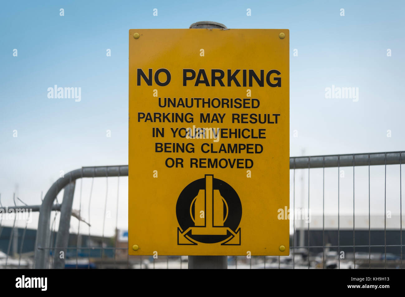 No Parking sign, unauthorised parking may result in your vehicle being clamped or removed. - Stock Image