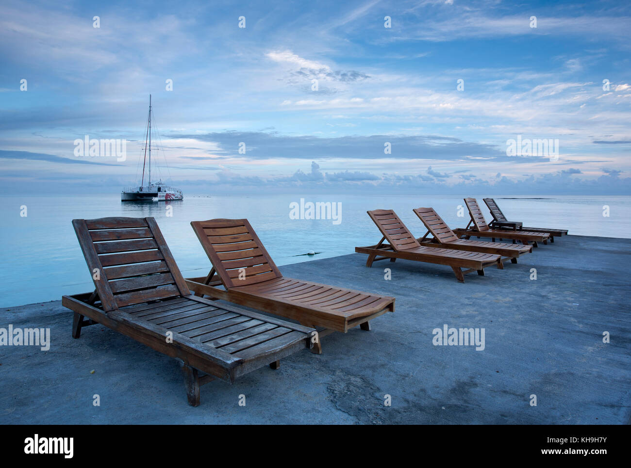 Deck Chairs On Jetty Near Ocho Rios, Jamaica, Caribbean, West Indies   Stock