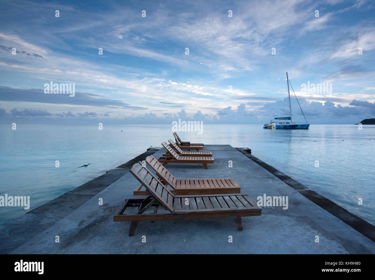 Deck Chairs On Jetty Near Ocho Rios, Jamaica, Caribbean, West Indies