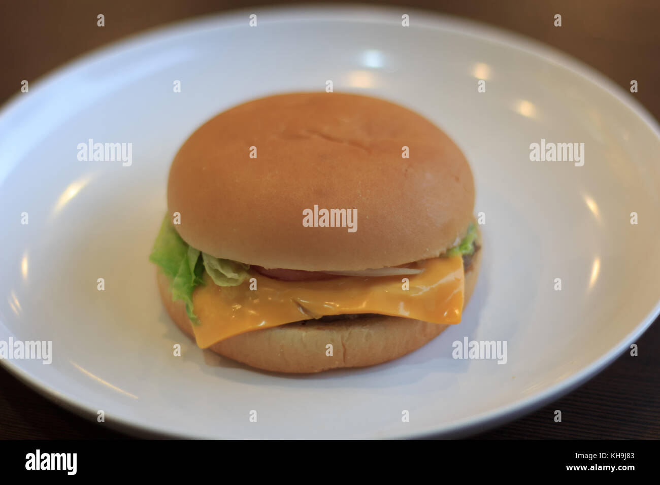 Close-up burger, burger select focus on a white plate lowl ight or underexposed, burger breakfast - Stock Image