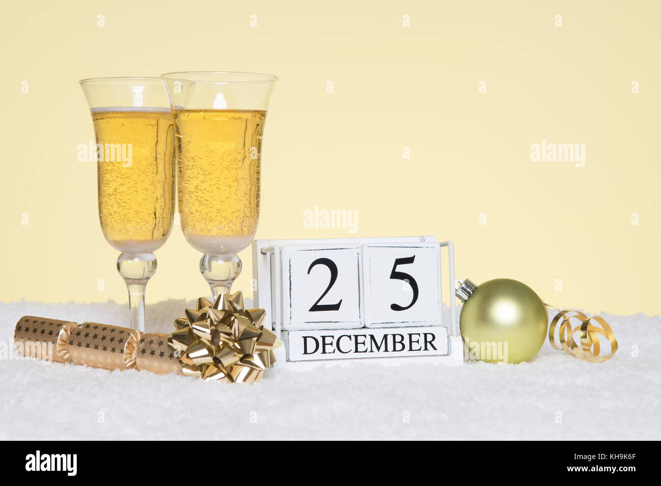 Christmas party still life with two glasses of Champagne and a date block showing 25th December. Copy space on the Stock Photo