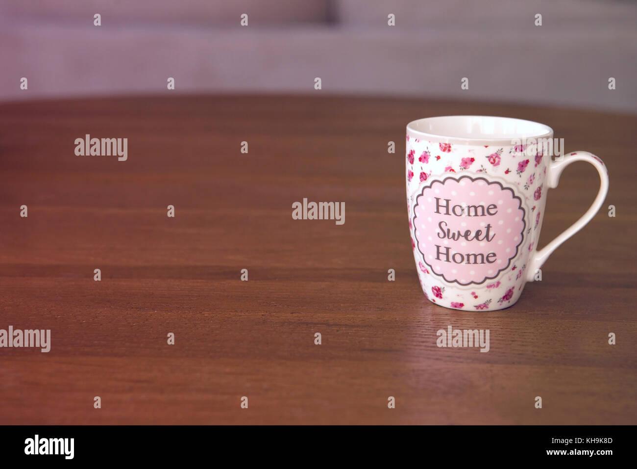 Home sweet home mug on wood table - Stock Image