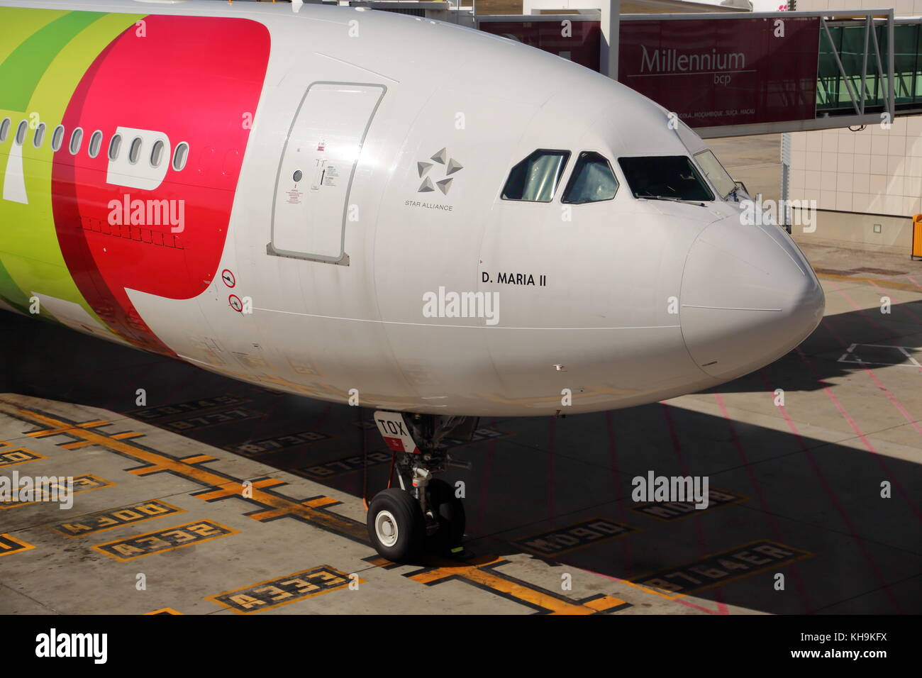 A TAP Airbus A330 CS-TOX passenger plane at the gate at Lisbon Airport, Portugal - Stock Image