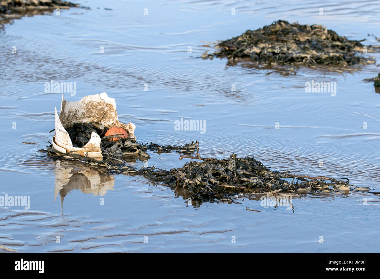 Discarded plastic products washed up on to Southport beach in Merseyside. - Stock Image