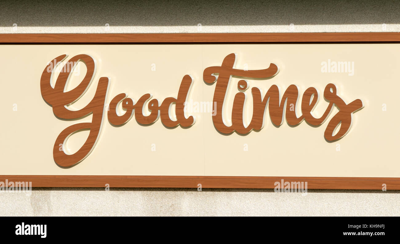 A 'Good Times' sign on side of building in Southport, Merseyside. - Stock Image