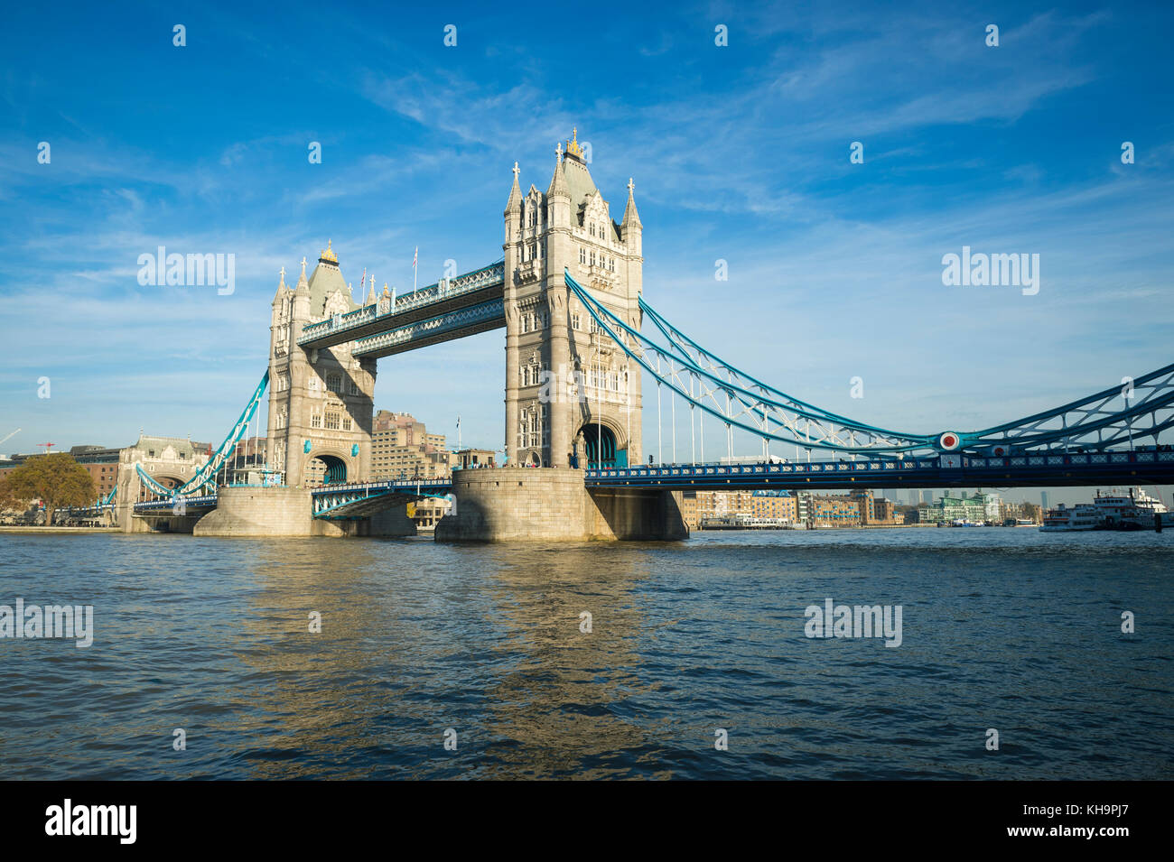 Scenic landscape view of Tower Bridge standing tall in afternoon light above the River Thames as viewd from the - Stock Image