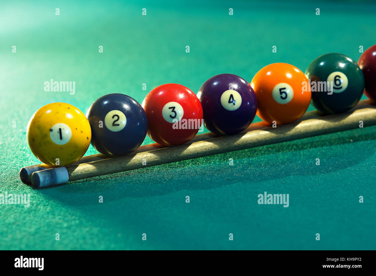 Horizontal photo of a billiard table with the billiard balls arranged in sequence - Stock Image