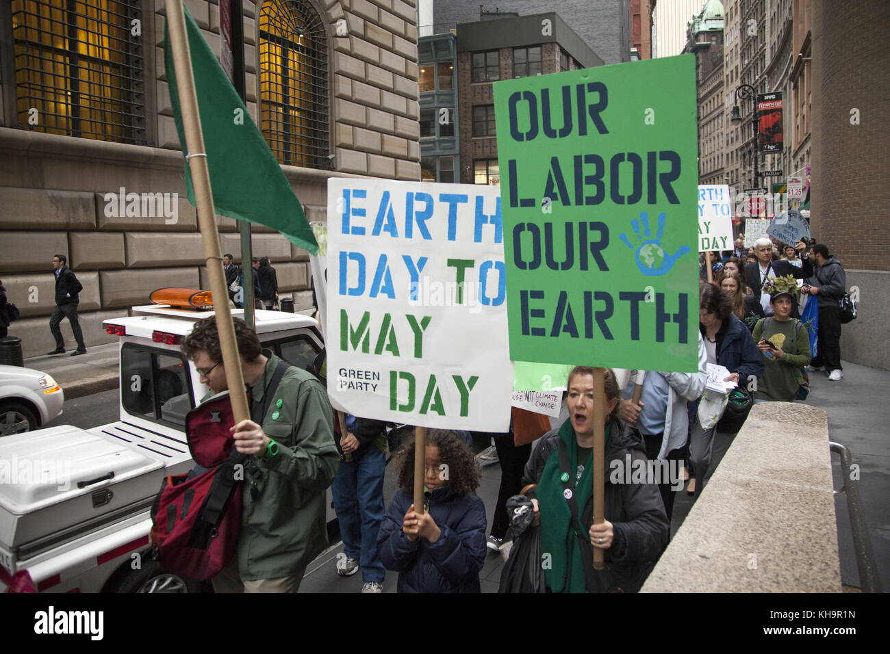 Environmental activists rally on Earth Day at Zuccotti Park, then march to Wall Street calling for system change - Stock Image