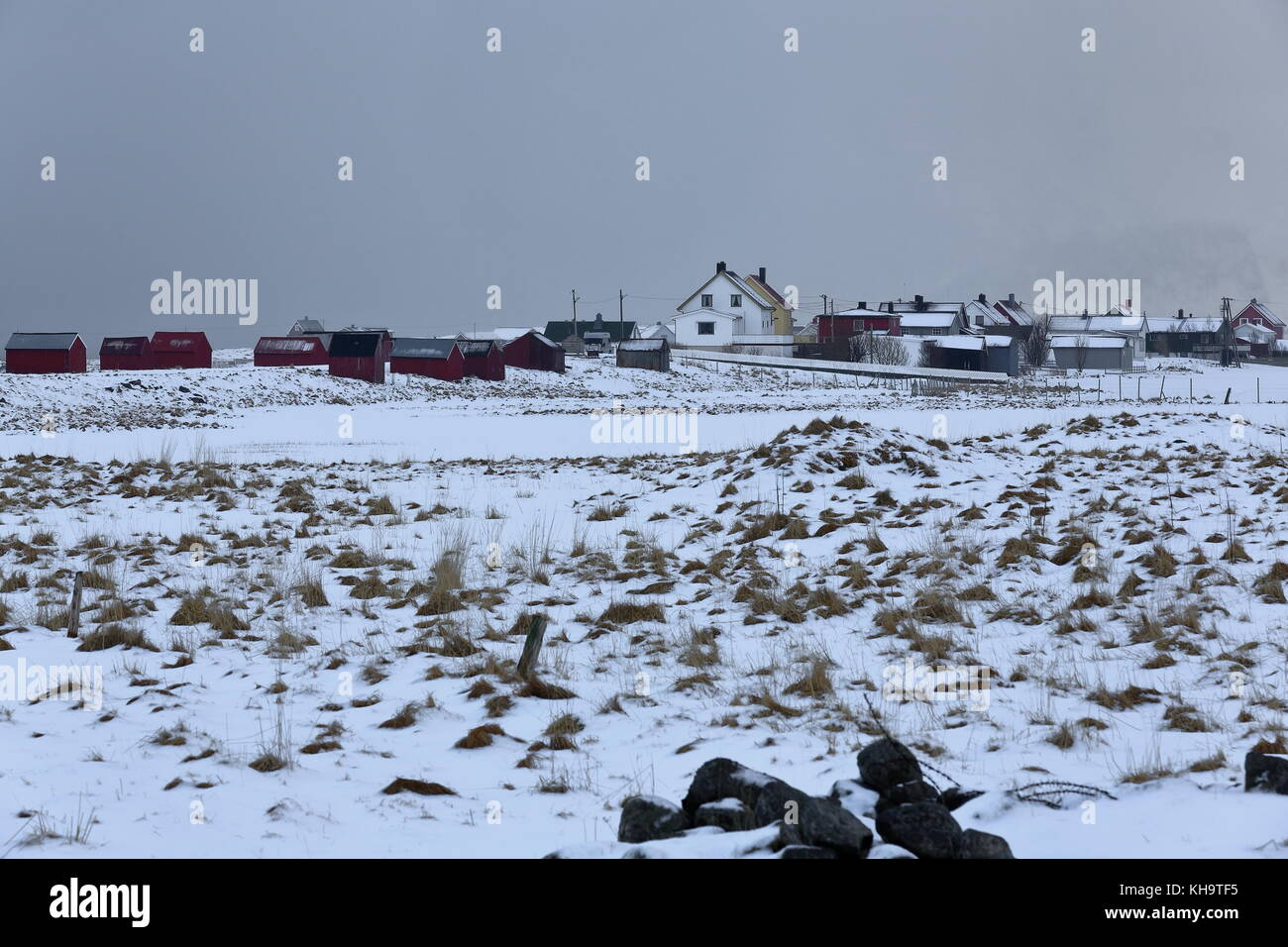 SE.-wards view from Eggum Natur Reserve to the rorbuer-fishing huts and cottages of Eggum village under heavy snowstorm - Stock Image