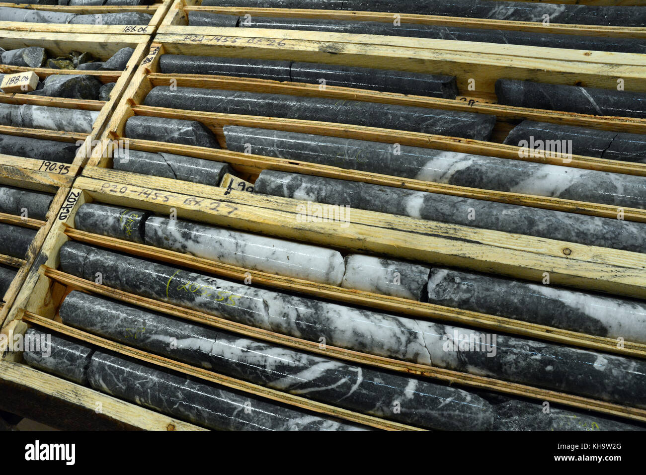 Rock core samples taken by a mining exploration company prospecting for gold, near Stewart, British Columbia, Canada. - Stock Image