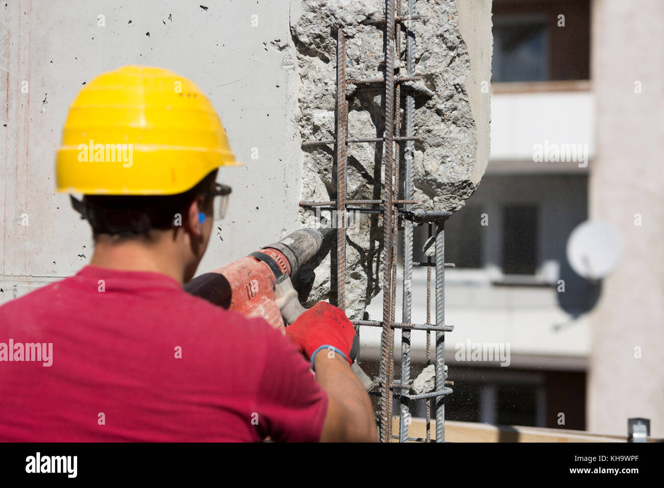 Construction worker using a drilling power tool. - Stock Image
