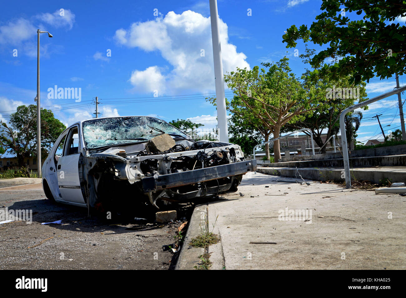 Abandoned vehicles and tattered roads are the new normal in places like Mayagüez, Puerto Rico, Nov. 14, 2017. - Stock Image