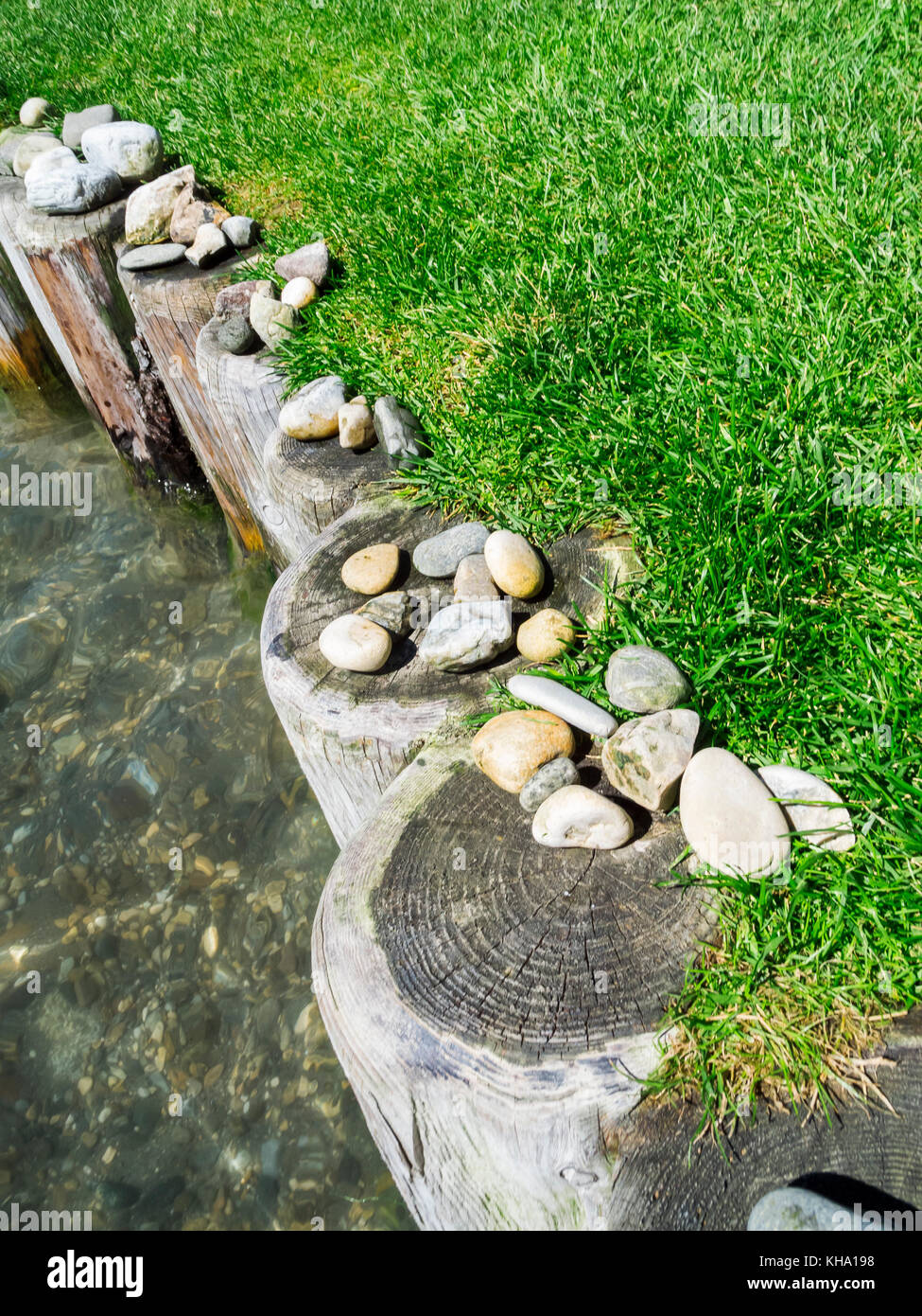 Elevated slanted view of a stone banked wooden bank attachment at Lake Kaltern - Stock Image