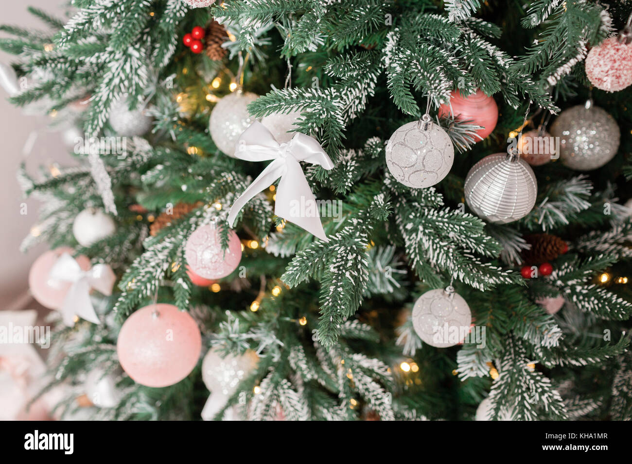 Christmas Tree Decorated With Toys In Silver And Pink Color In It