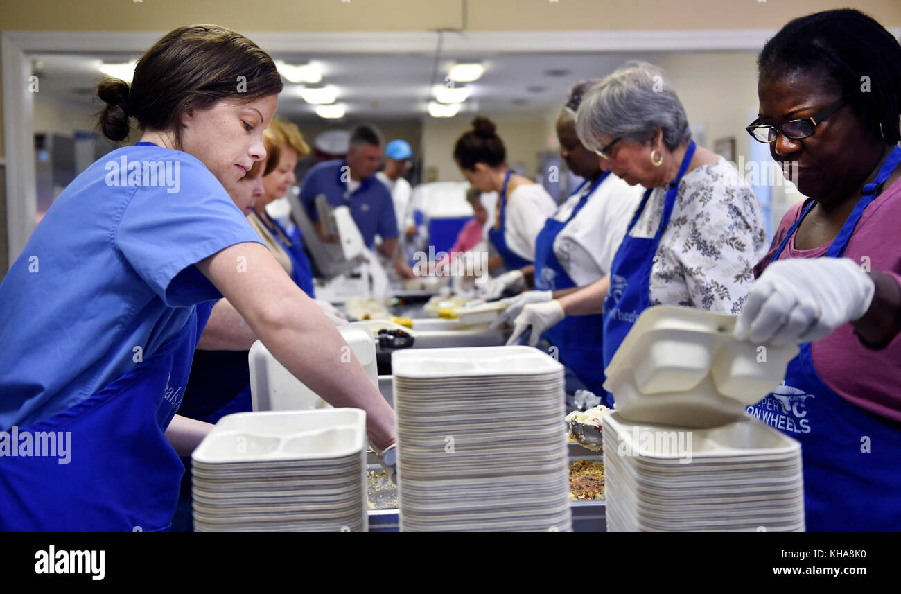 East Cooper Meals on Wheels volunteers prepare food for residents in need Oct. 10, 2016. The Meals on Wheels team's - Stock Image