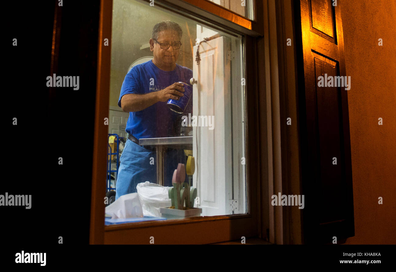Arturo Suarez, East Cooper Meals on Wheels volunteer, makes coffee for other volunteers Oct. 10, 2016. The Meals - Stock Image