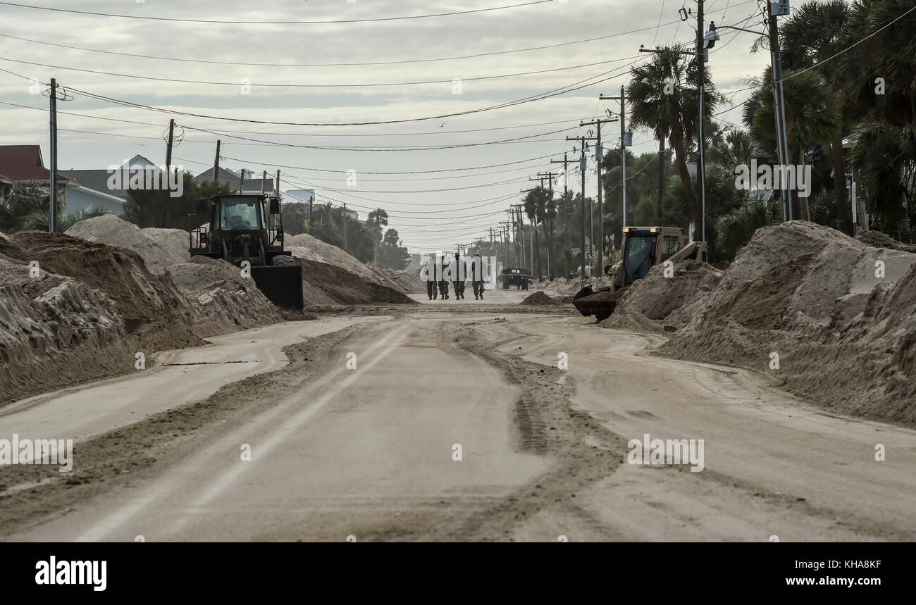 South Carolina Army National Guard soldiers walk down the recently-cleared streets of Edisto Beach, South Carolina, - Stock Image