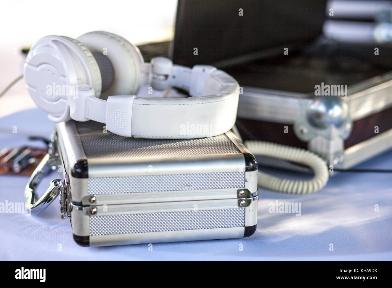 Dj Table For Wedding With Headphones, Suitcases And Laptop. Selective Focus    Stock Image