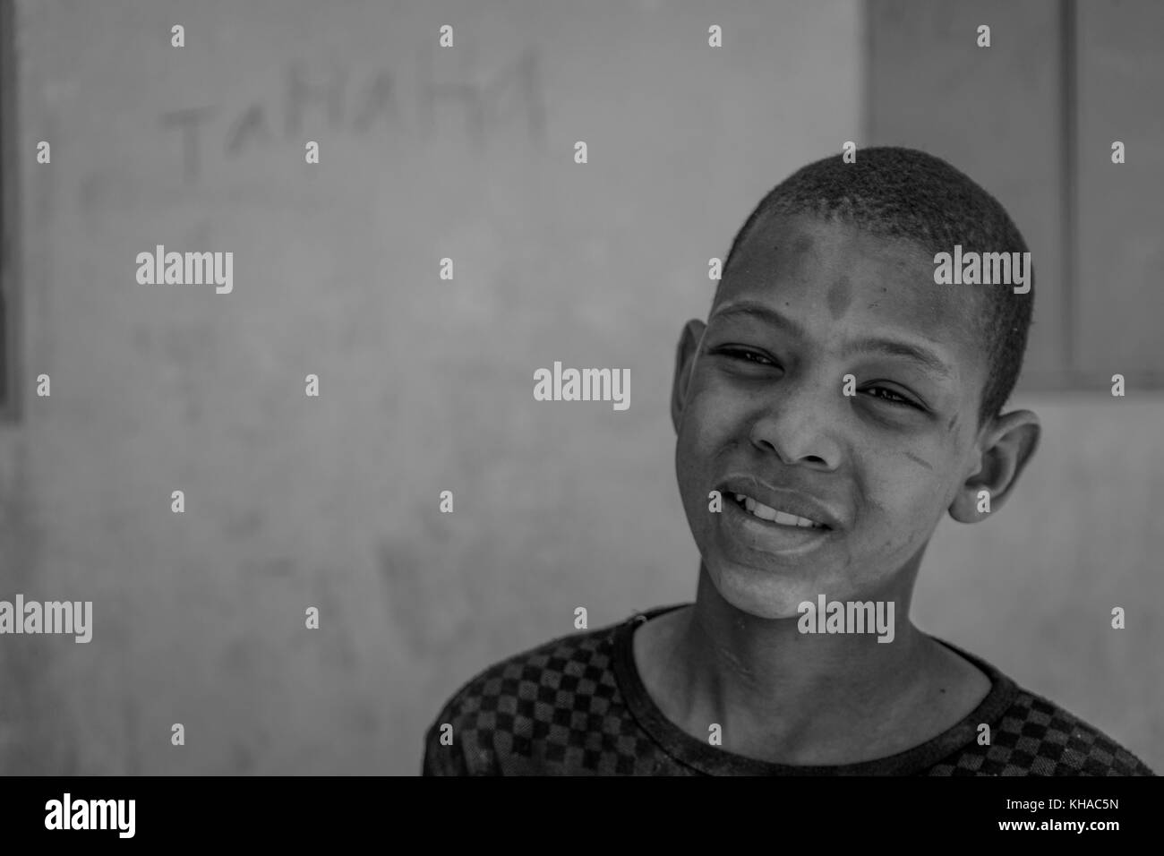 African Boy looking towards the camera. Taken in Mali. - Stock Image