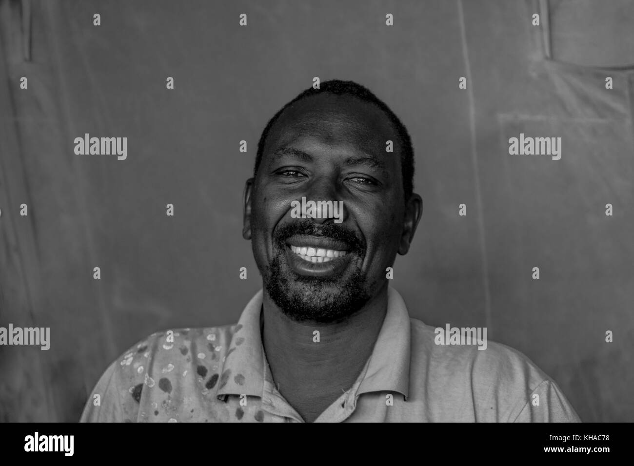 A portrait shot of a African man laughing in Mali. - Stock Image