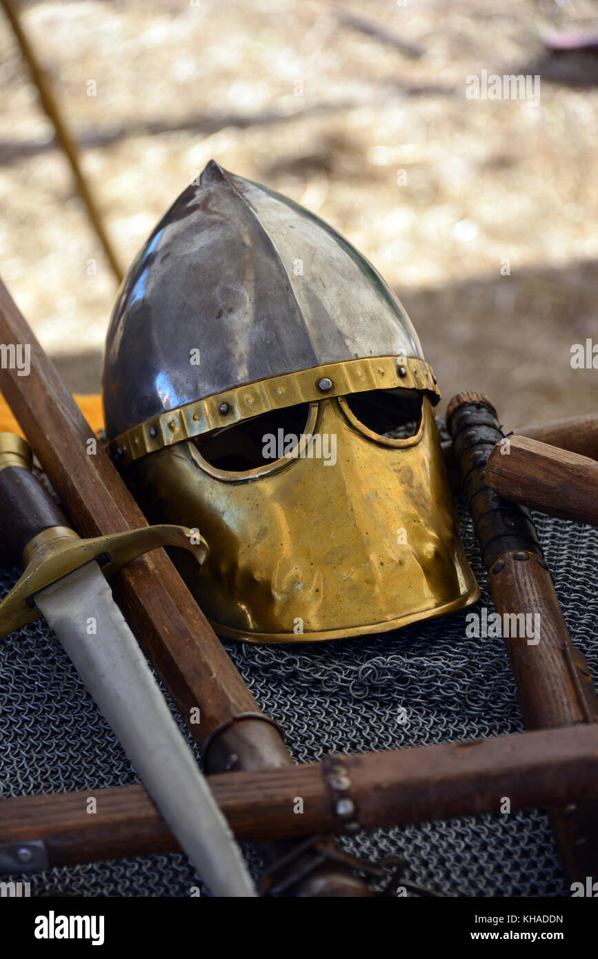 medieval style helmets on display at Medieval festival in village of Le Bosc, Herault languedoc, France - Stock Image