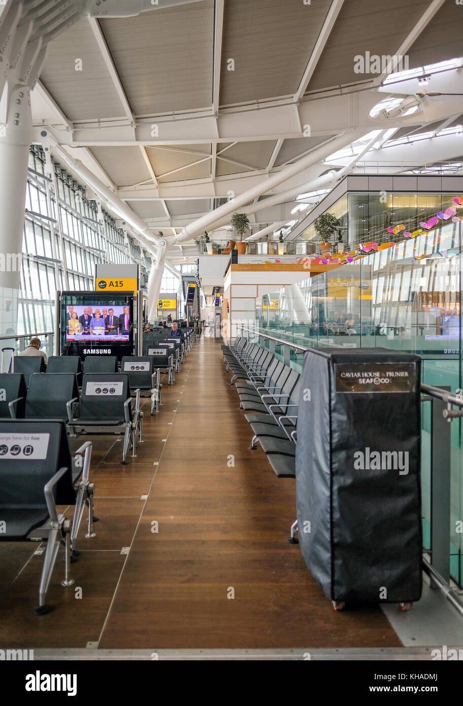 Heathrow, Terminal 5, London, UK - September 25, 2017:  Inside Terminal 5, charging your technology area.  Quiet - Stock Image