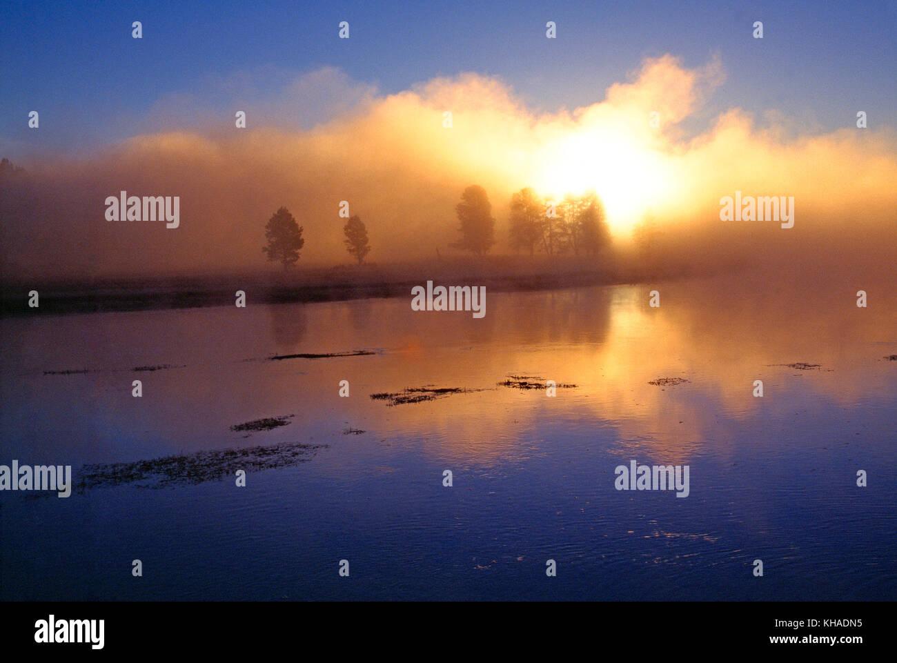 USA. Wyoming. Yellowstone National Park. Misty sunrise over Alum Creek. Stock Photo