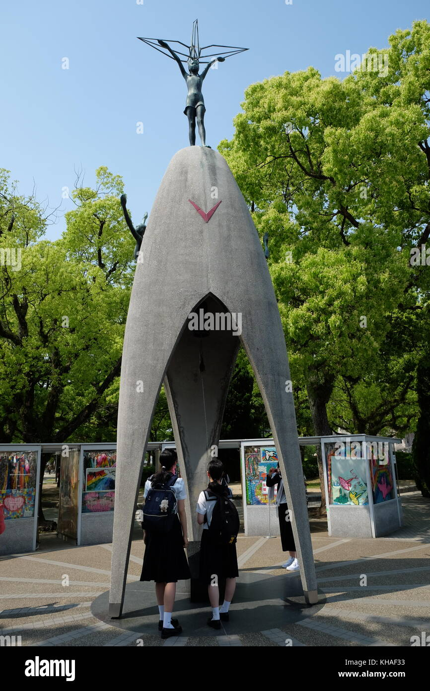 Japanese school children at the Children's Peace Monument. - Stock Image