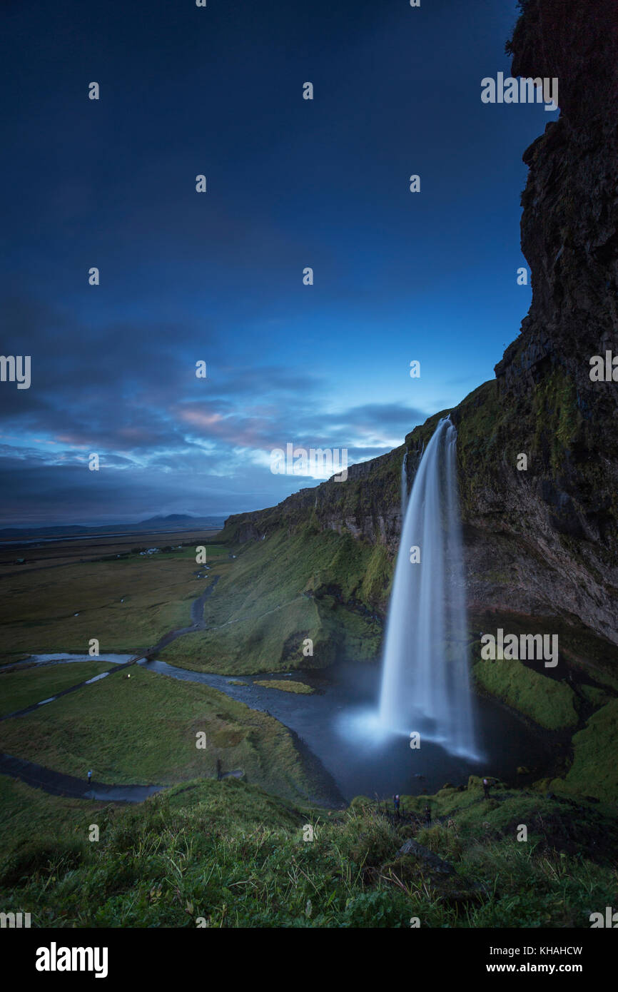 Seljalandsfoss waterfall on the south coast of Iceland. A well known tourist destination. - Stock Image