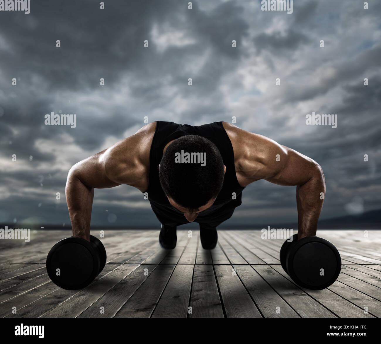 Man doing pushups outdoor - Stock Image