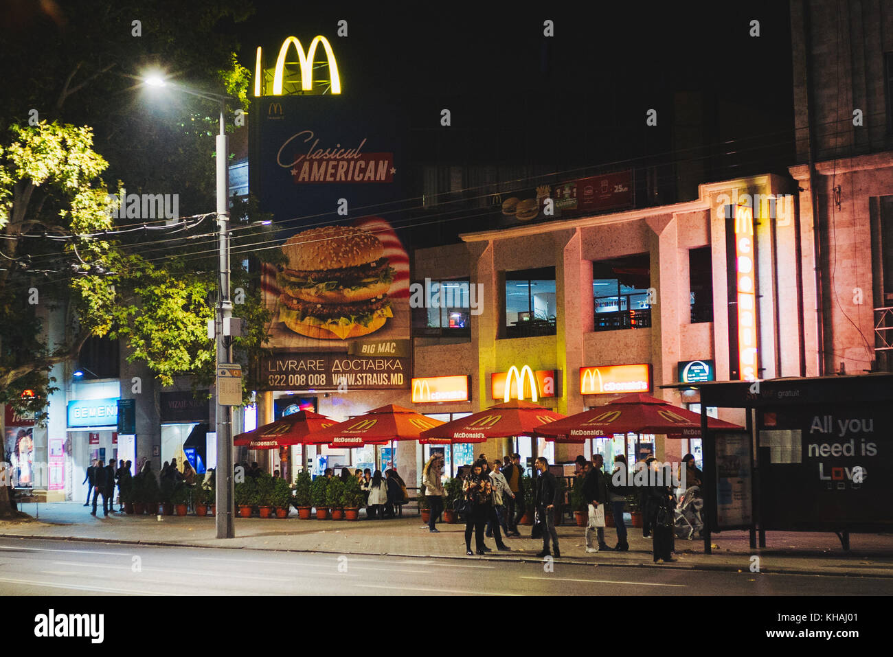 One of the few McDonald's restaurants in Chisinau, Moldova, advertises a 'Classical American' Big Mac - Stock Image