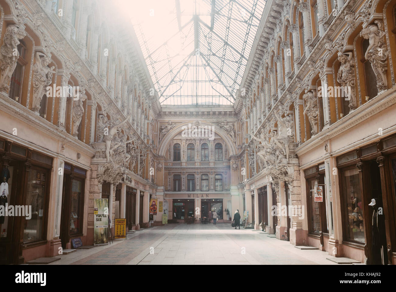 A shopping arcade lit up by the afternoon sun in Odessa, Ukraine - Stock Image