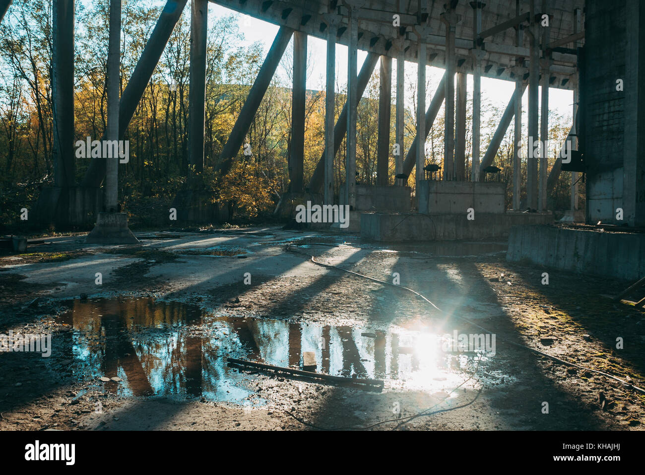 Exploring the inside of an abandoned hyperboloid nuclear cooling tower in Chernobyl, Ukraine one sunny afternoon - Stock Image