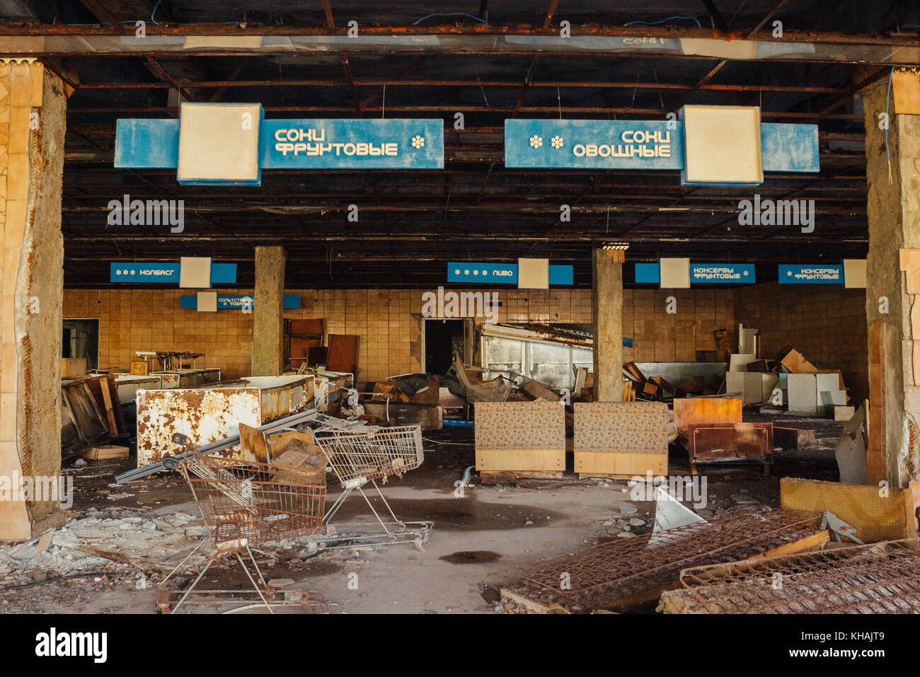 An abandoned supermarket complete with shopping trollies in the model Soviet town of Pripyat, as seen 30 years after - Stock Image