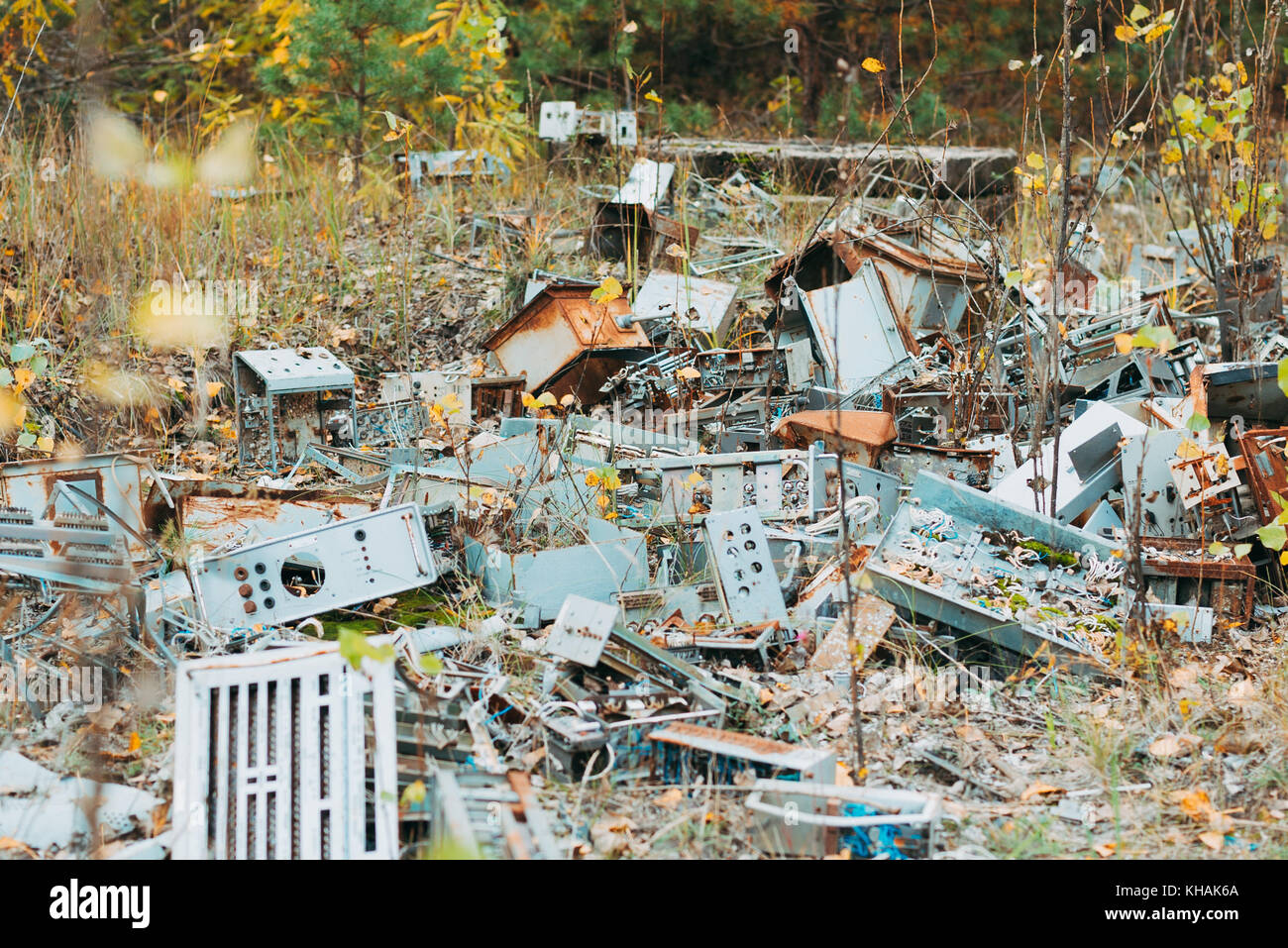 Smashed parts from 1980s computers lie resting in a field in Chernobyl, Ukraine - Stock Image