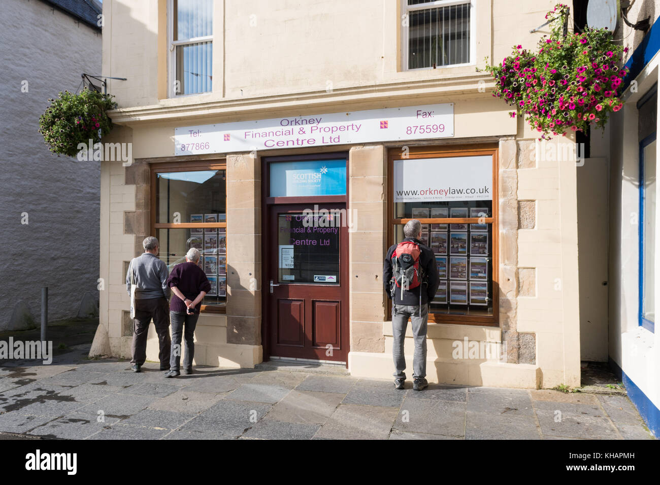 people looking in the windows of Orkney Financial and Property Centre estate agency, Kirkwall, Orkney, Scotland, - Stock Image