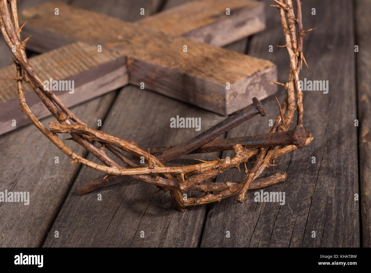 Crown Of Thorns And Nails Closeup And Cross In Background On A Wood Stock Photo Alamy