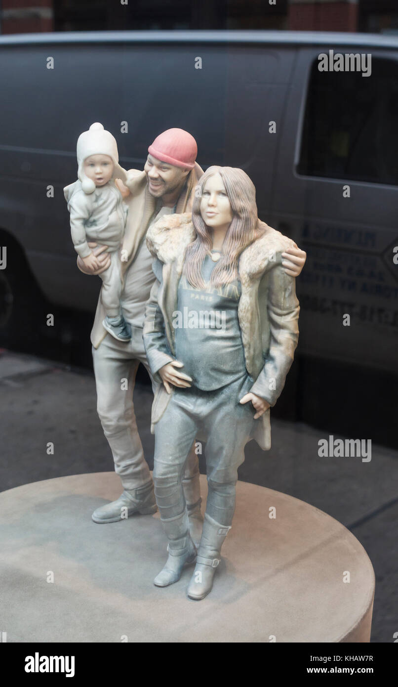A Doob 3-D figurines of a family of three - Stock Image