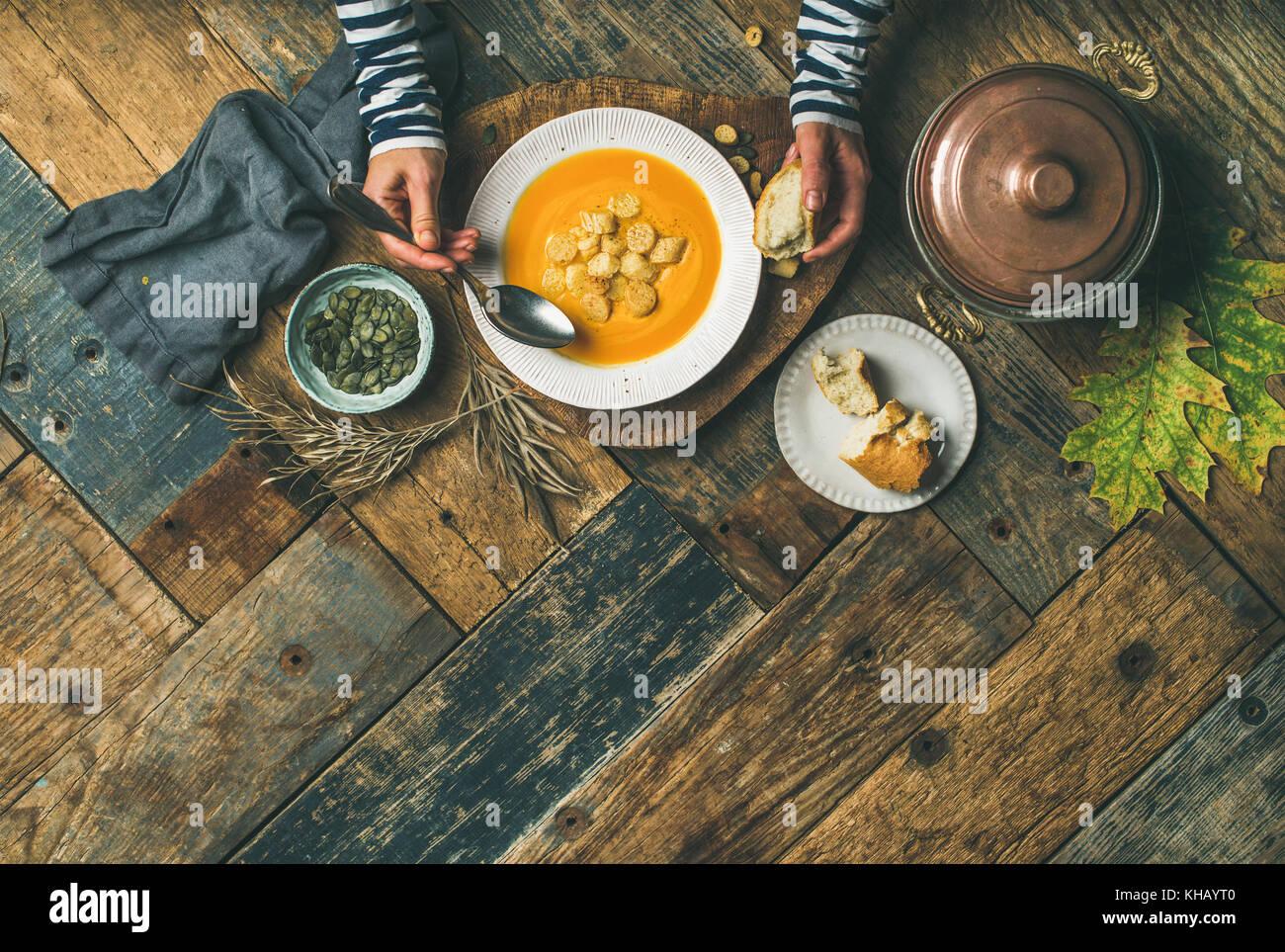 Fall warming pumpkin cream soup, copy space Stock Photo