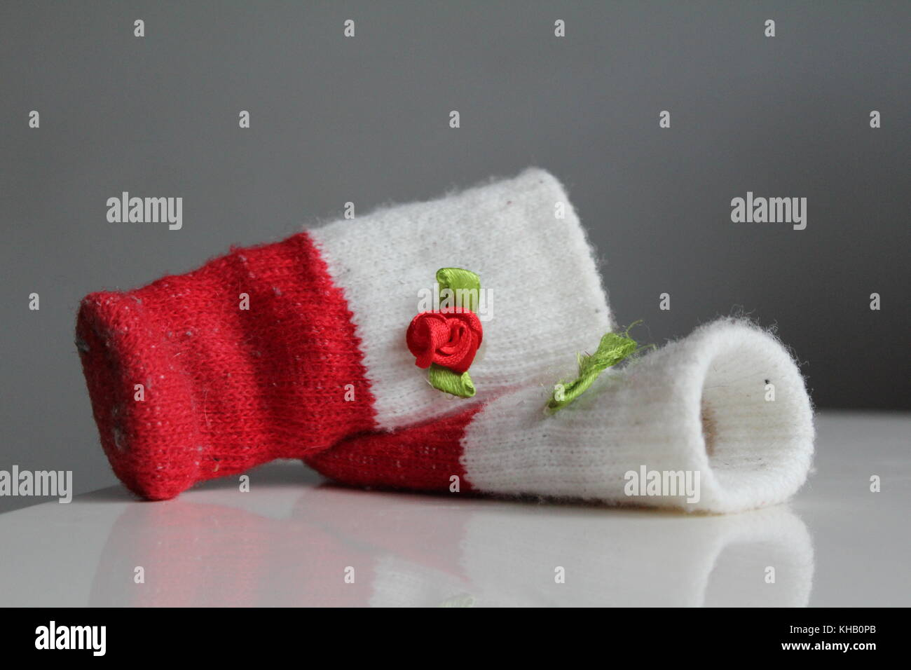 red sock on table - Stock Image