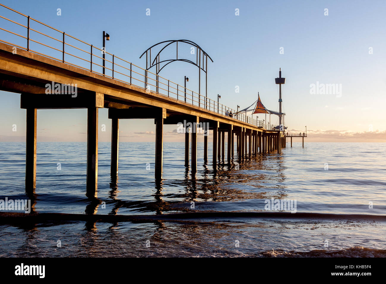 Sunset at Brighton beach, showing the concrete jetty which has abstract features. - Stock Image